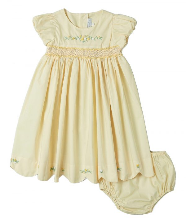 Yellow hand-smocked dress with scalloped edging and floral detail from Fantaisie Kids